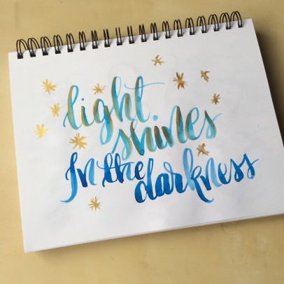 a random lettering sketch with watercolor and finetec gold ink